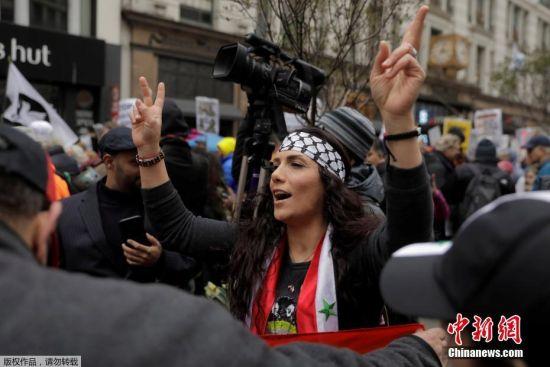 500万彩票网app:美国民众反战游行_抗议特朗普对叙军事打击(图)