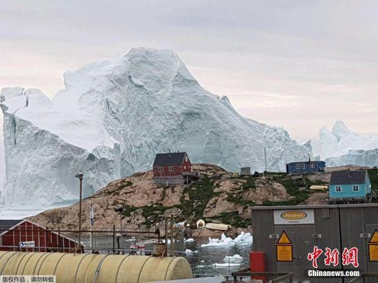 百万发娱乐平台合法吗:巨型冰山逼近村庄_一旦崩解可能会引发海啸(图)